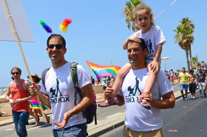 An Israeli gay couple walk with their daughter in the annual Gay Pride Parade in Tel Aviv. Photo: UPI